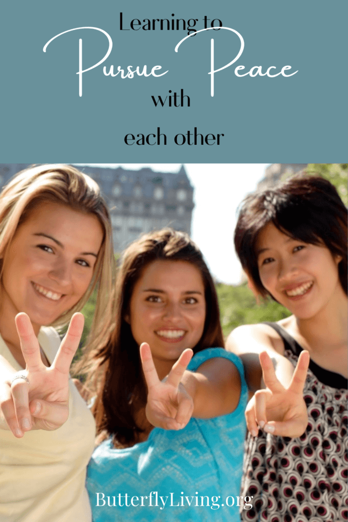3 girls with peace sign-pursuing peace