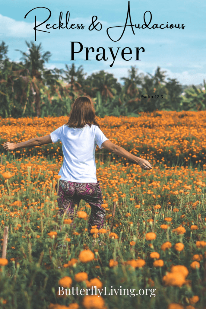 Lady with arms raised-Reckless Prayer