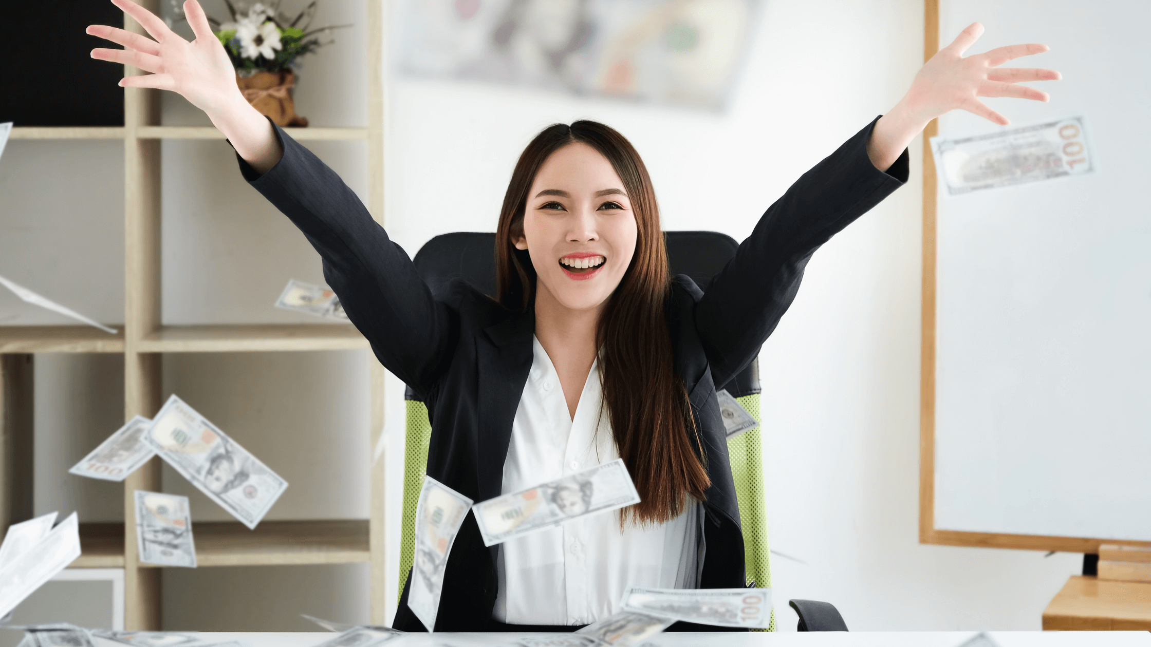 lady with arms raised-finding financial freedom